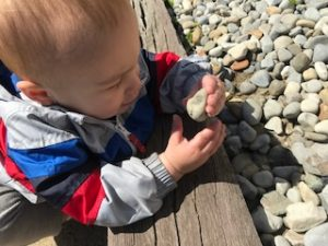 Silas playing with a rock