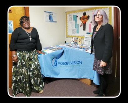 Dr. Kia Everett and Valerie Melroy at the resource table
